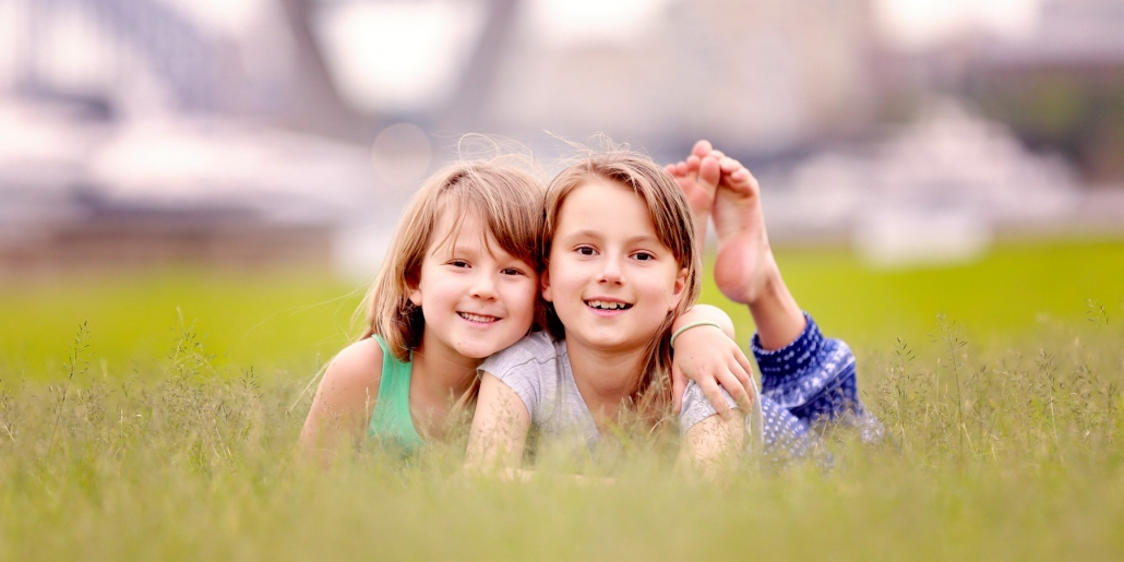 sisters photograph in tall grass